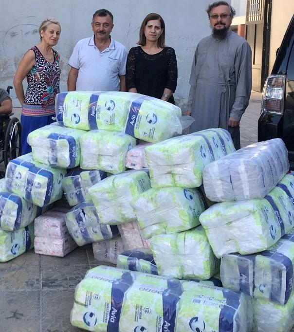 Передача гуманитарной помощи школе «Амаль» в Дамаске